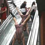 The Acro-Chaps - Victorian Strongmen - Handstands on the Escalators